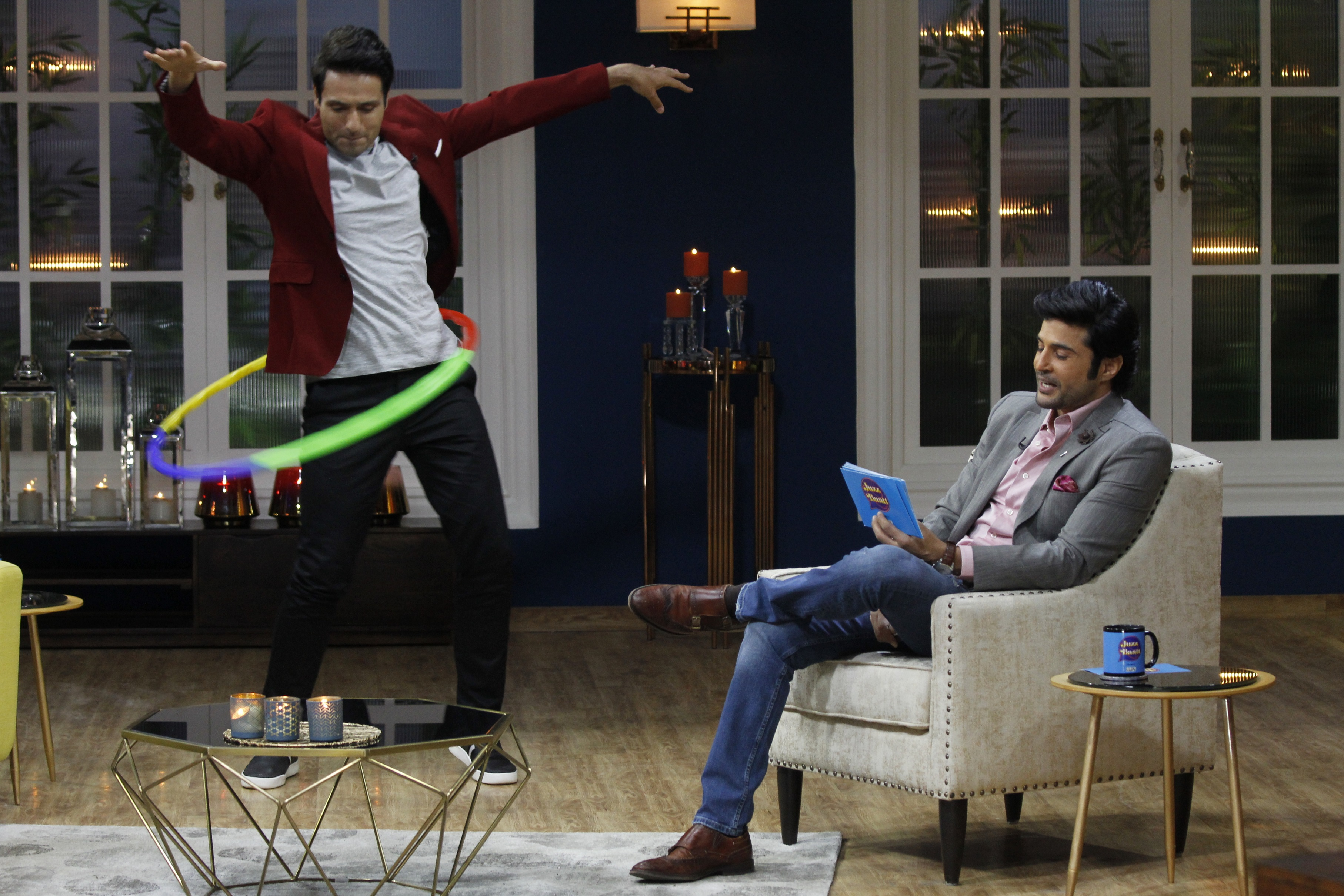 Iqbal Khan trying the hoolahoop on sets of JuzzBaatt
